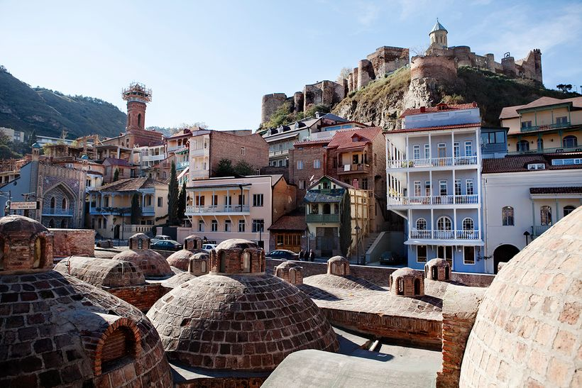 Historic sulphur baths and carved wooden balconies in Tbilisi, Georgia
