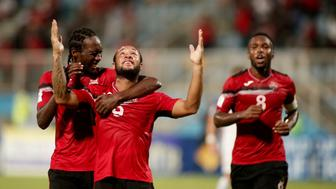 Trinidad and Tobago's Shahdon Winchester (C) celebrates with teammates after scoring against the United States during their 2018 World Cup qualifier football match in Couva, Trinidad and Tobago, on October 10, 2017. / AFP PHOTO / Abraham Diaz        (Photo credit should read ABRAHAM DIAZ/AFP/Getty Images)