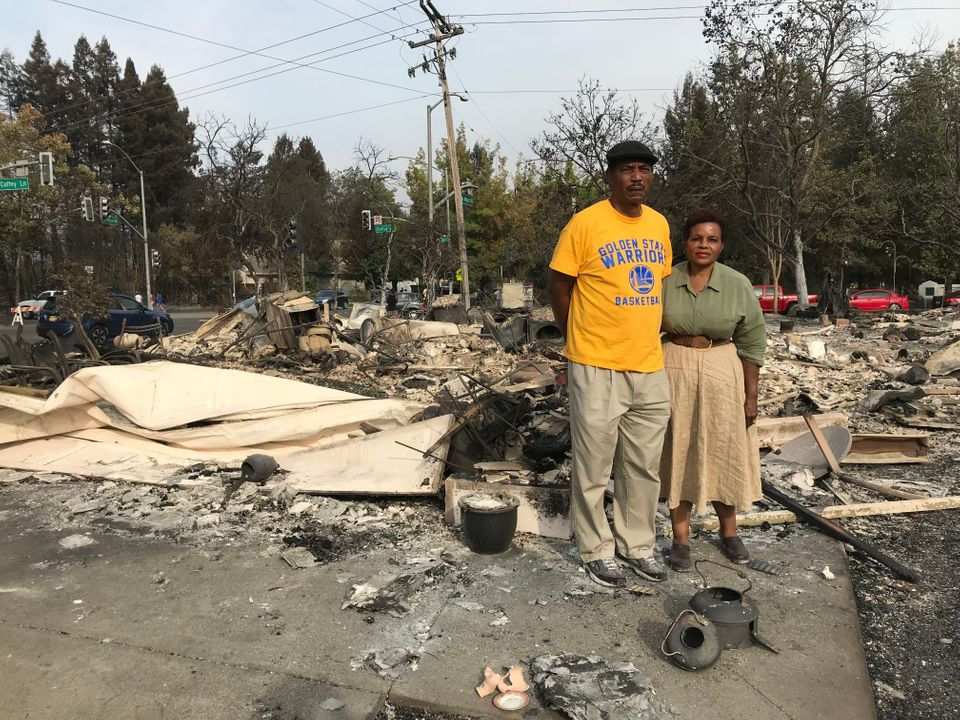 Marion and Lloid Heim stand amid the ashes of their Santa Rosa home. They had moved in just a year