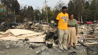 Marion Heim right and husband Lloid Heim stand on the ashes where their house used to be in Santa Rosa CA