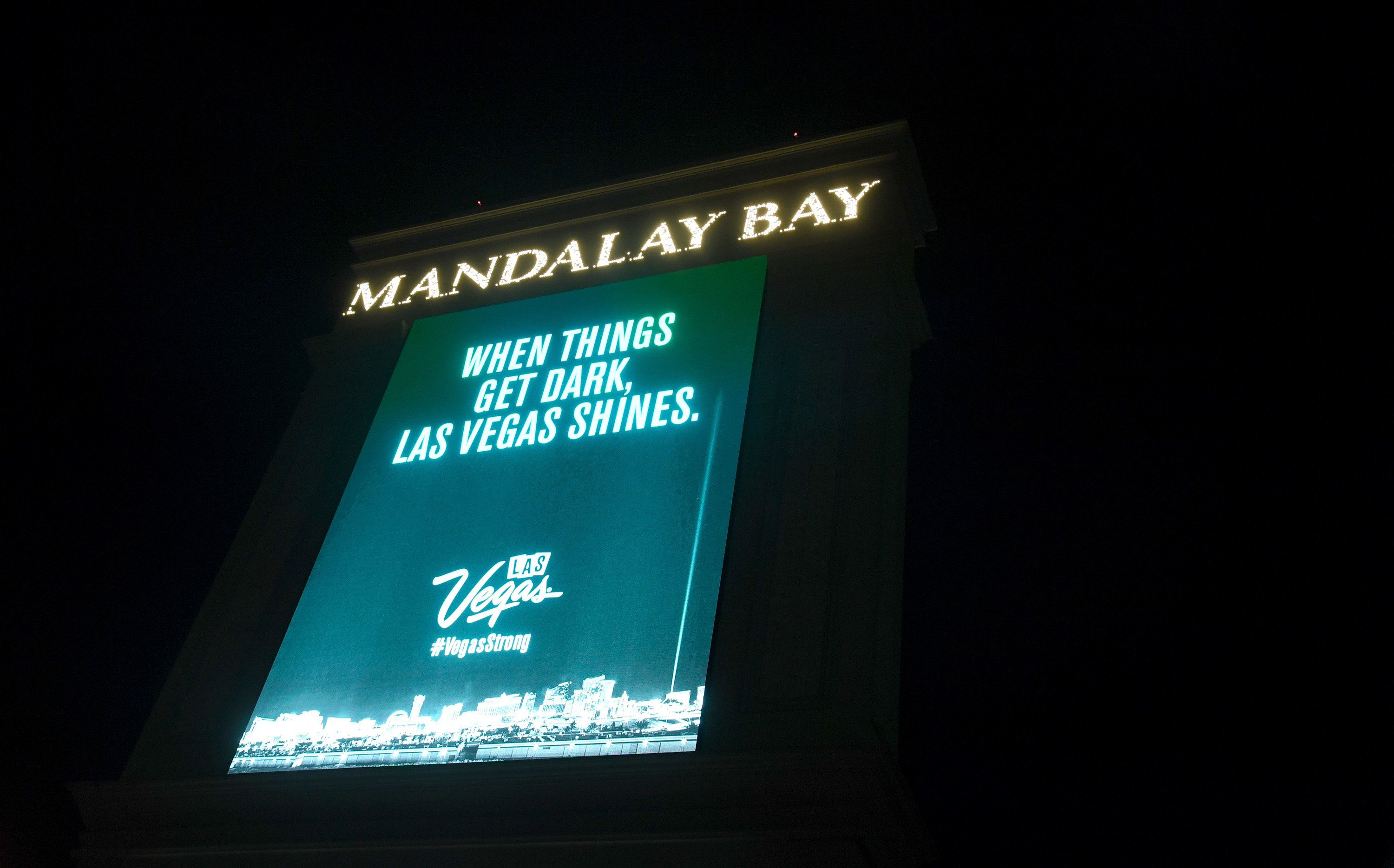 LAS VEGAS, NV - OCTOBER 08:  A marquee at Mandalay Bay Resort and Casino displays a message in tribute to the victims of last Sunday night's mass shooting on October 8, 2017 in Las Vegas, Nevada. The marquees at resorts all along the Las Vegas Strip displayed the message 'When things get dark, Las Vegas shines.' after they went dark at 10:05 p.m. for 11 minutes Sunday night, marking the time and duration one week ago of the shooting at the Route 91 Harvest country music festival. Stephen Paddock killed 58 people and injured more than 450 when he opened fire on the crowd from the 32nd floor of Mandalay Bay. The massacre is one of the deadliest mass shooting events in U.S. history.  (Photo by Ethan Miller/Getty Images)
