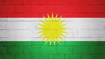 Flag of Kurdistan painted on a brick wall.