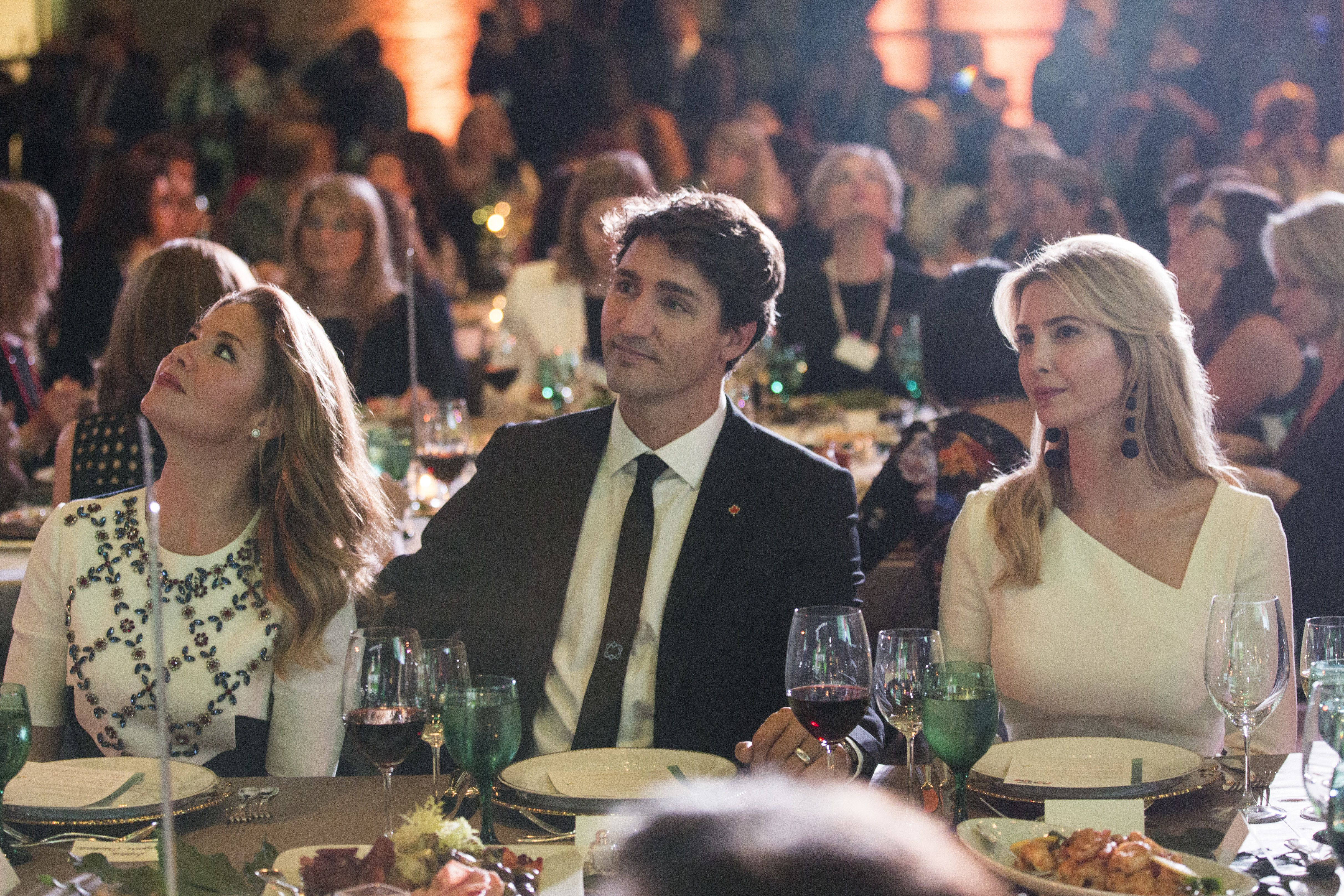 Sophie Trudeau, Canada's first lady, left, Justin Trudeau, Canada's prime minister, center, and Ivanka Trump listen during the Fortune's Most Powerful Women conference in Washington, D.C., U.S., on Tuesday, Oct. 10, 2017.