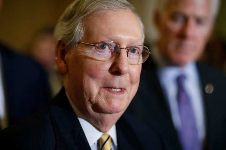 Mitch McConnell is feeling the heat from conservative groups to do more to confirm President Donald Trump's judicial nominees