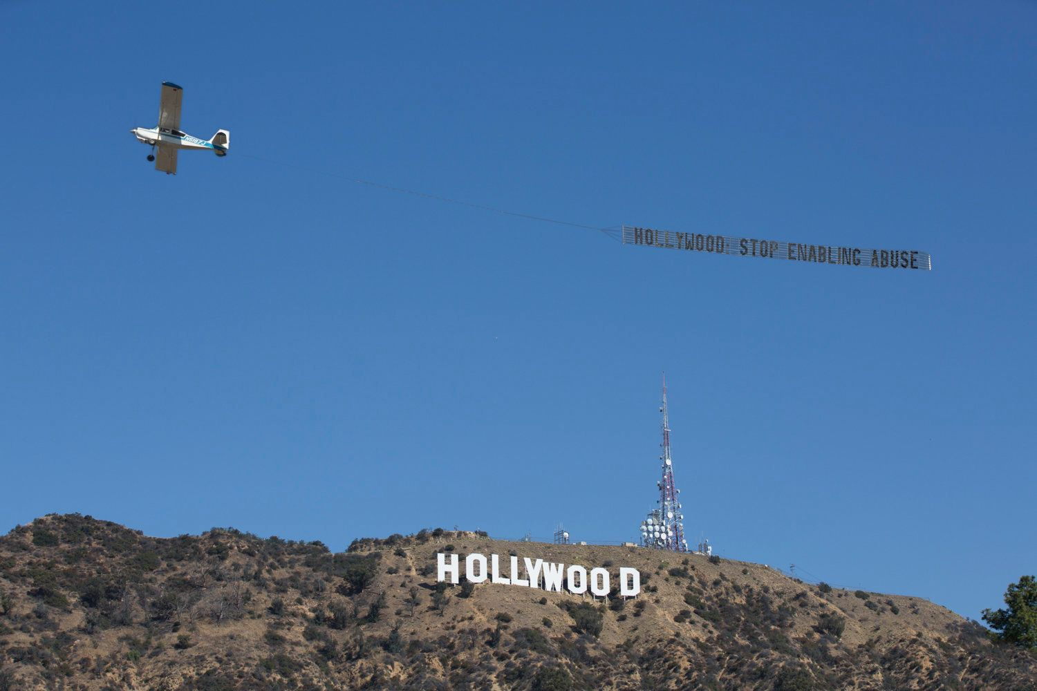 """Hollywood: Stop enabling abuse,"" the sign read."
