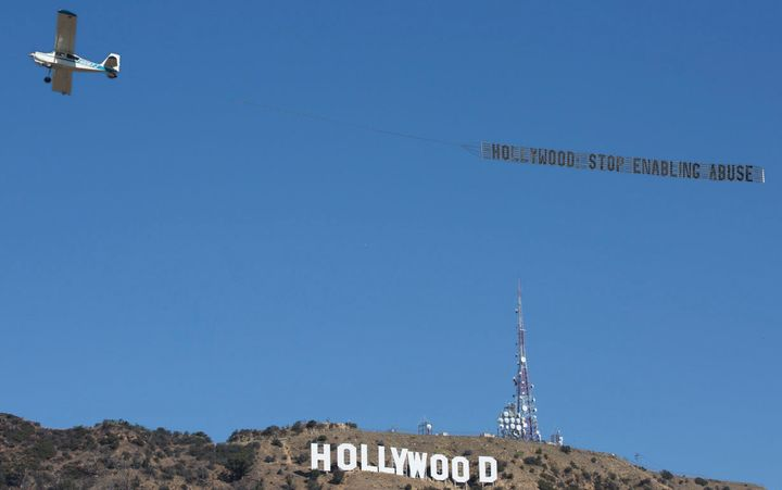 """""""Hollywood: Stop enabling abuse,"""" the sign read."""