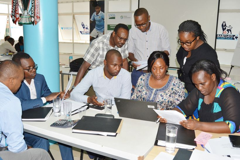 Barclays Bank of Kenya employees engaging in group discussions during AIMS/ECAF training held last year