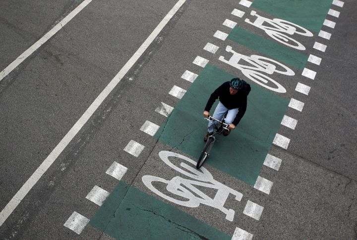 A cyclist pedals along Chicago's network of bike lanes.