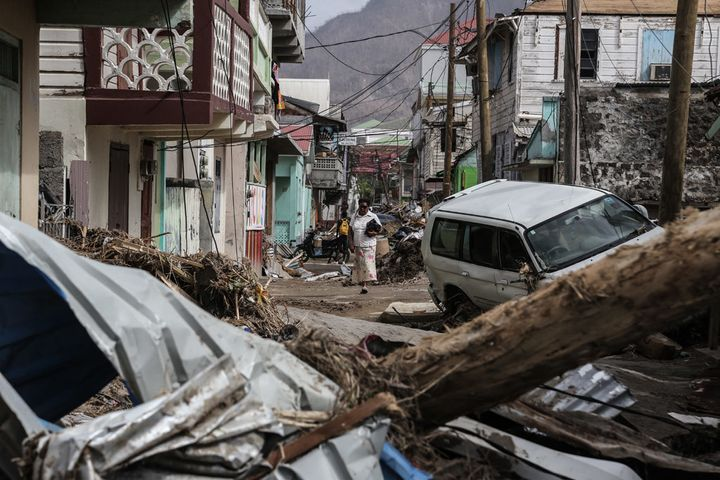 A woman walks in the street of Roseau, capital of Dominica, which is struggling to overcome the severe impact of two categor