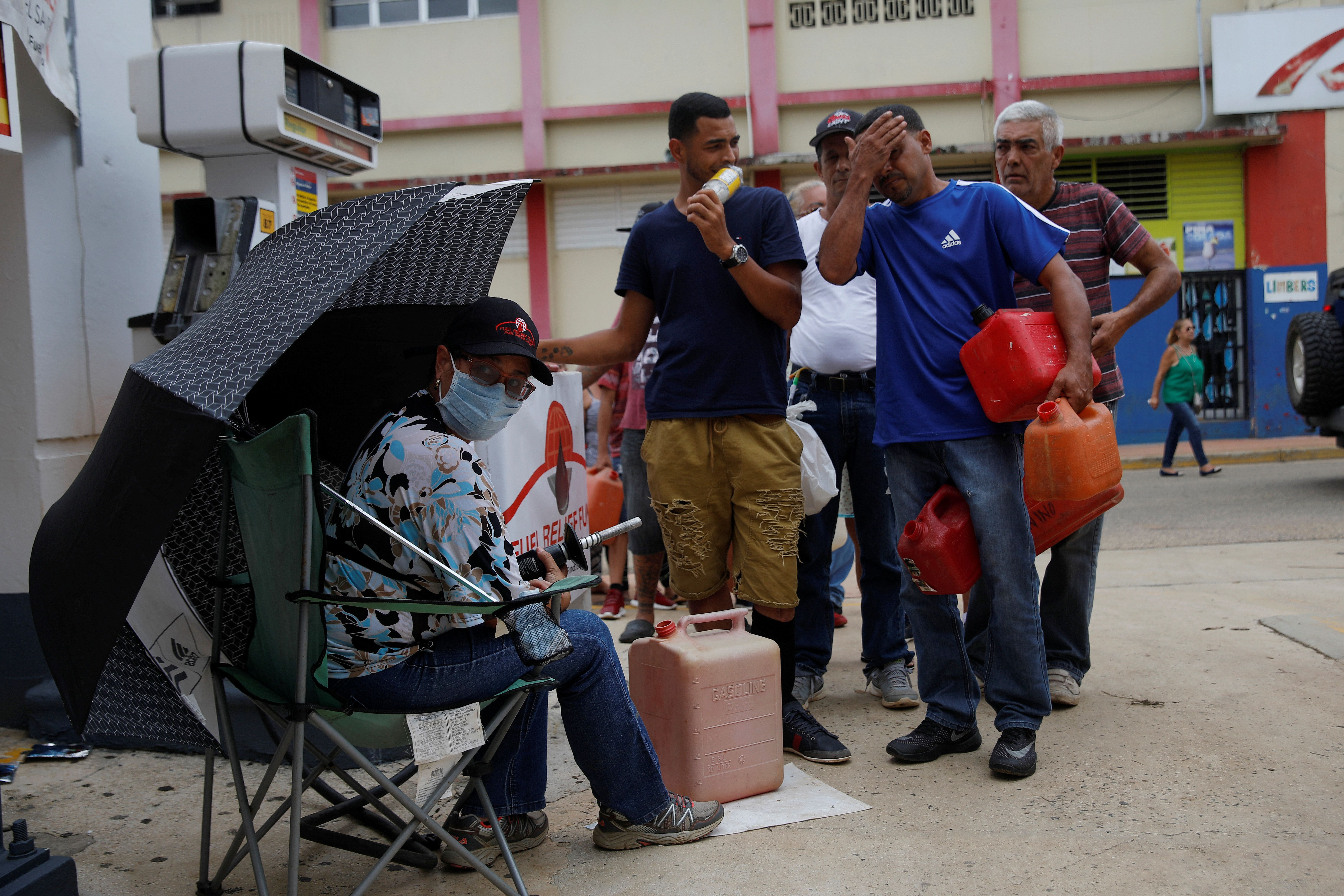 Residents affected by Hurricane Maria wait in line for fuel donated by the Fuel Relief Fund in the municipality of Orocovis, outside San Juan, Puerto Rico, October 10, 2017. REUTERS/Shannon Stapleton