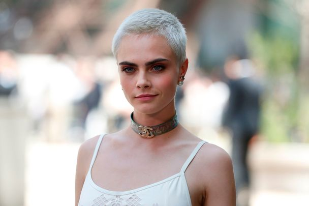 British model and actress Cara Delevingne poses during the photocall before Chanel 2017-2018 fall/winter Haute Couture collection show in Paris on July 4, 2017.  / AFP PHOTO / Patrick KOVARIK        (Photo credit should read PATRICK KOVARIK/AFP/Getty Images)
