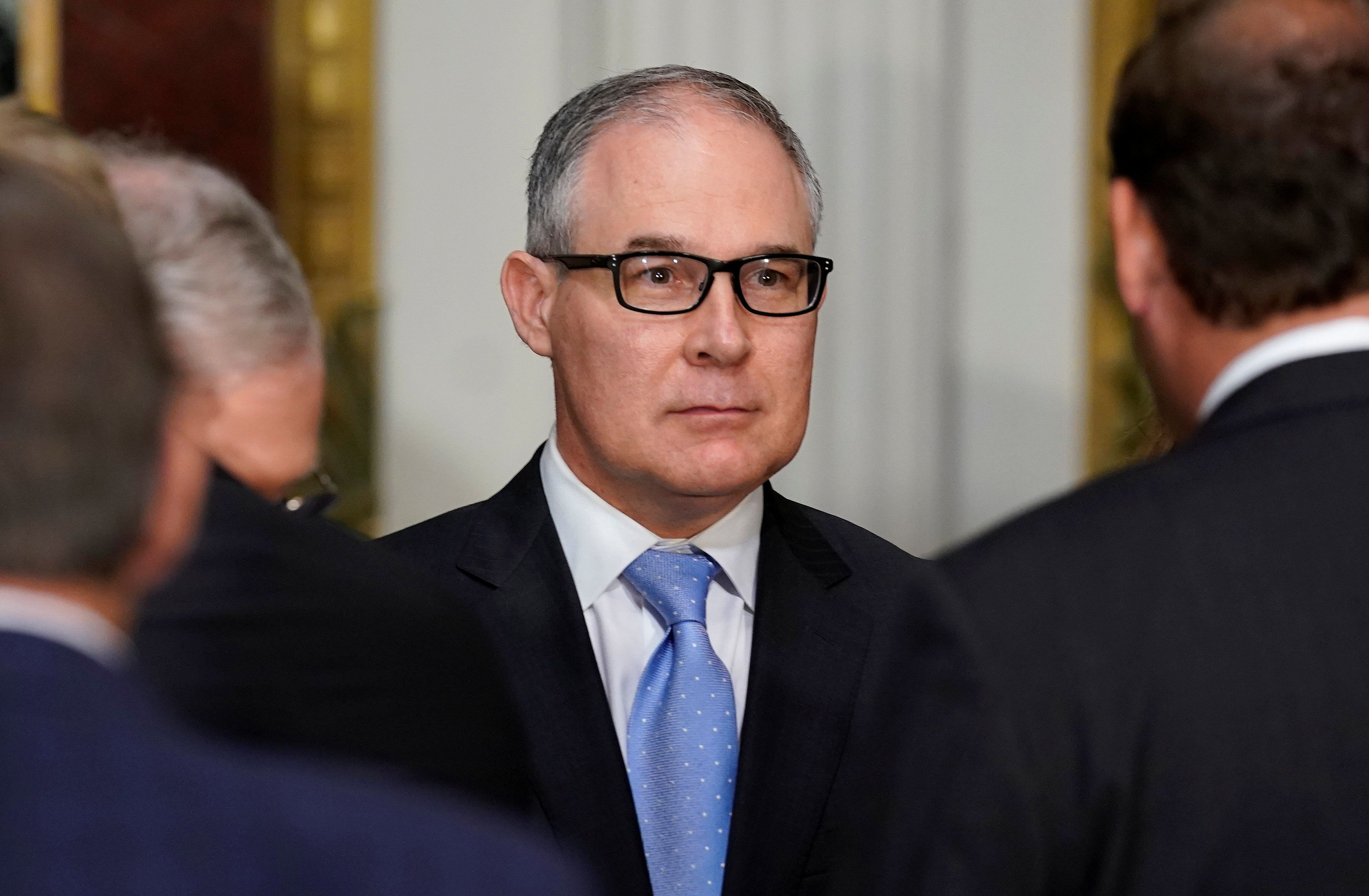 Administrator of the Environmental Protection Agency Scott Pruitt stands after the swearing-in ceremony for US Ambassador to Canada Kelly Knight Craft in Washington, U.S., September 26, 2017.   REUTERS/Joshua Roberts