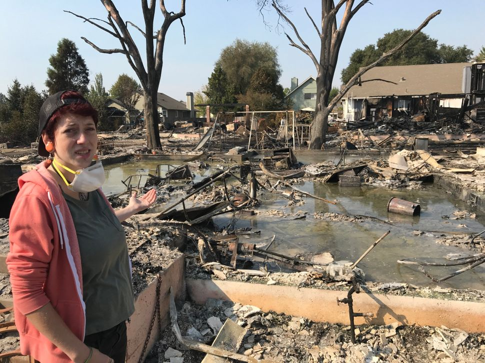 Kat Keller stands in front of what used to be her family's home.