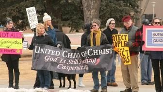 Revered Dee Lundberg and UCC members protest the Defense Of Marriage Act