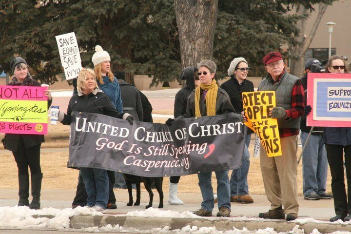 Rev. Dee Lundberg and Casper UCC members protest the Defense Of Marriage Act.
