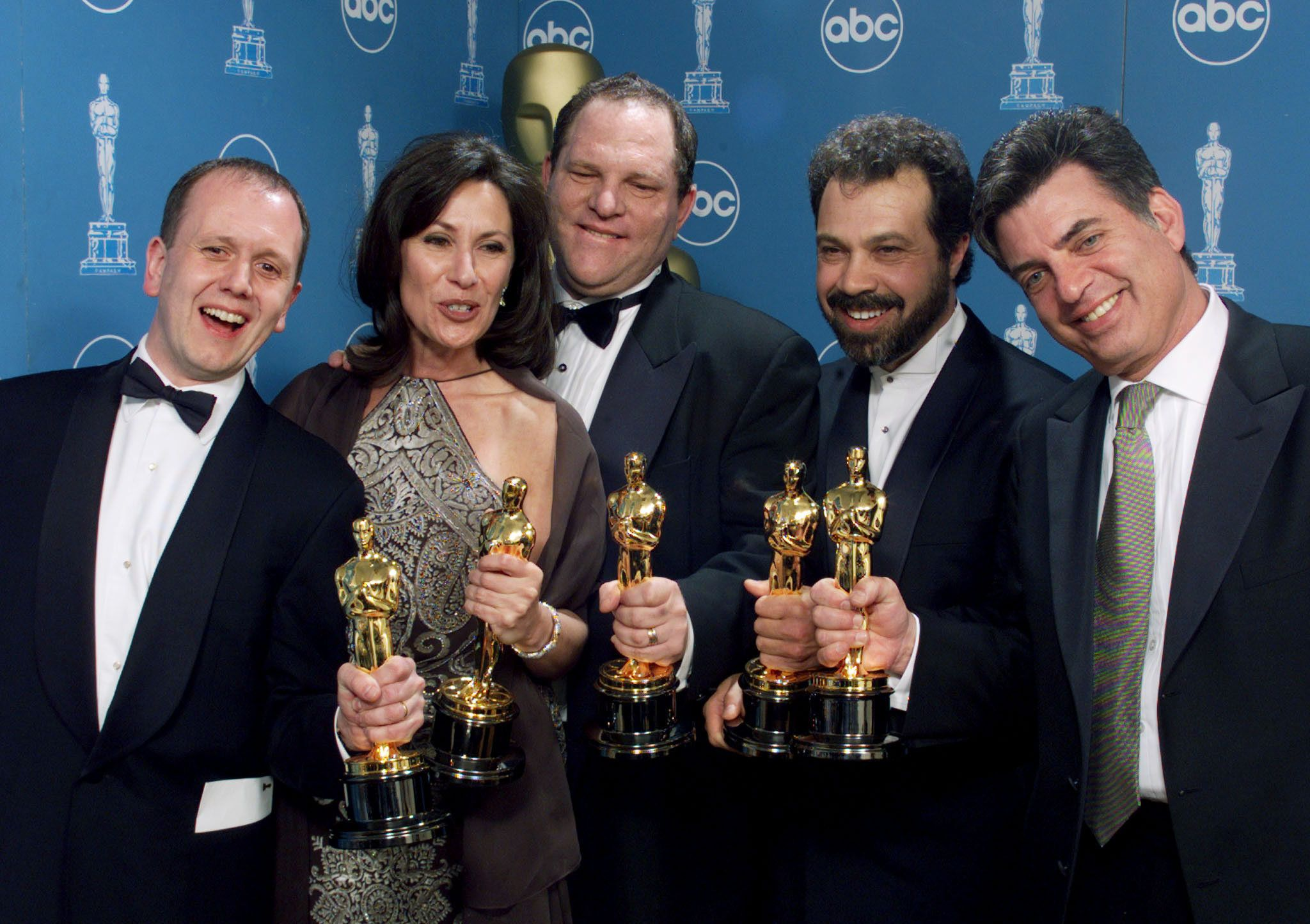 """The producers of the Miramax film """"Shakespeare in Love"""" hold their Oscars after their film won Best Picture at the 71st Annual Academy Awards, March 21 at the Dorothy Chandler Pavilion in Los Angeles. From left are David Parfitt, Donna Gigliotti, Harvey Weinstein, Edward Zwick and Marc Norman. **DIGITAL IMAGE**"""