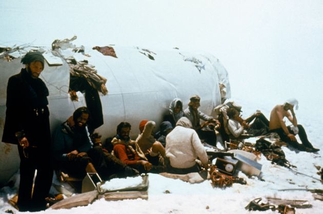 Survivors of the plane crash in the Andes pose for a picture in front of the plane's