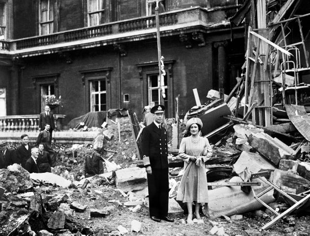 King George VI and Queen Elizabeth stand amid the bomb damage to Buckingham