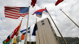An American flag flies outside the headquarters of the United Nations Educational, Scientific and Cultural Organization (UNESCO) in Paris, France, October 12, 2017.   REUTERS/Philippe Wojazer
