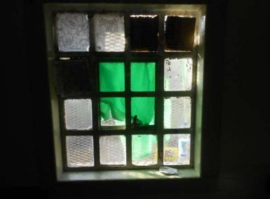 A broken window at HMP Swinfen Hall, in