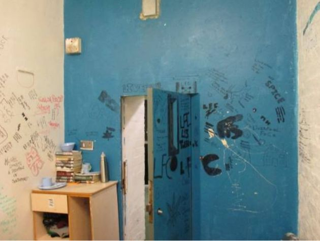 Graffiti and rubbish inside a cell at HMP