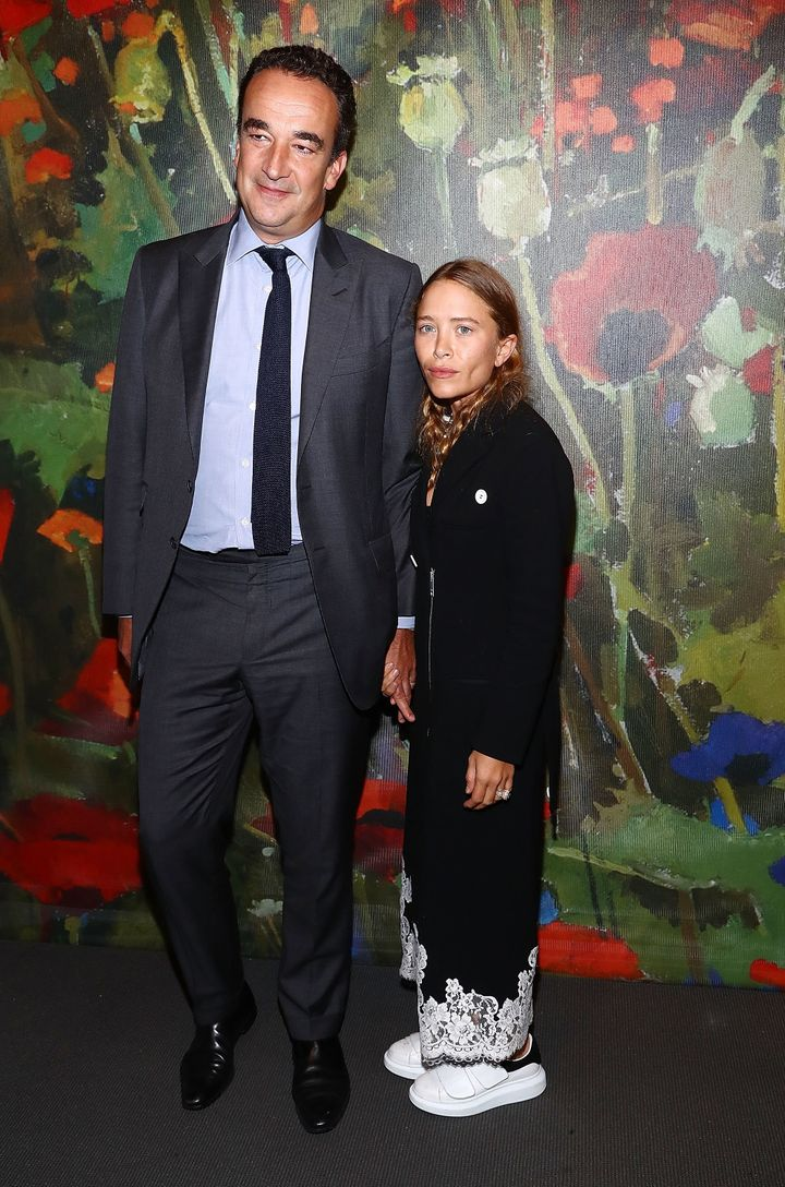 Mary-Kate Olsen and her husband, Olivier Sarkozy, attend the Take Home A Nude Art party and auction at Sotheby's on Oct. 11, 2017 in New York City.