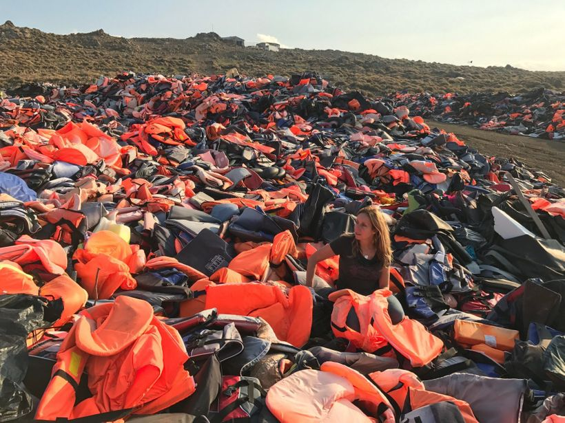 Longobardi sorts through the vast piles of plastic safety gear along the shores of Lesvos.