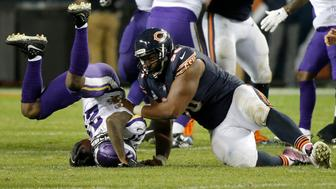 CHICAGO, IL - OCTOBER 09:   Akiem Hicks #96 of the Chicago Bears tackles  Jayron Kearse #27 of the Minnesota Vikings in the fourth quarter at Soldier Field on October 9, 2017 in Chicago, Illinois. The Minnesota Vikings defeated the Chicago Bears 20-17. (Photo by Jon Durr/Getty Images)