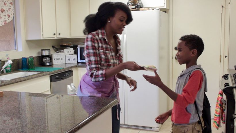 scene from film with Isiah Greene and  Chiyumba Ossome, who plays his mother.