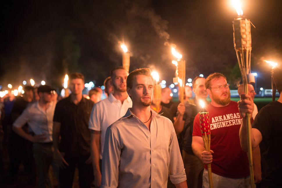 "White supremacists march with tiki torches through the University of Virginia campus the night before the ""Unite the Right"" r"