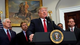 U.S. President Donald Trump speaks before signing an executive order, making it easier for Americans to buy bare-bone health insurance plans and circumvent Obamacare rules at the White House in Washington, U.S., October 12, 2017.  REUTERS/Kevin Lamarque