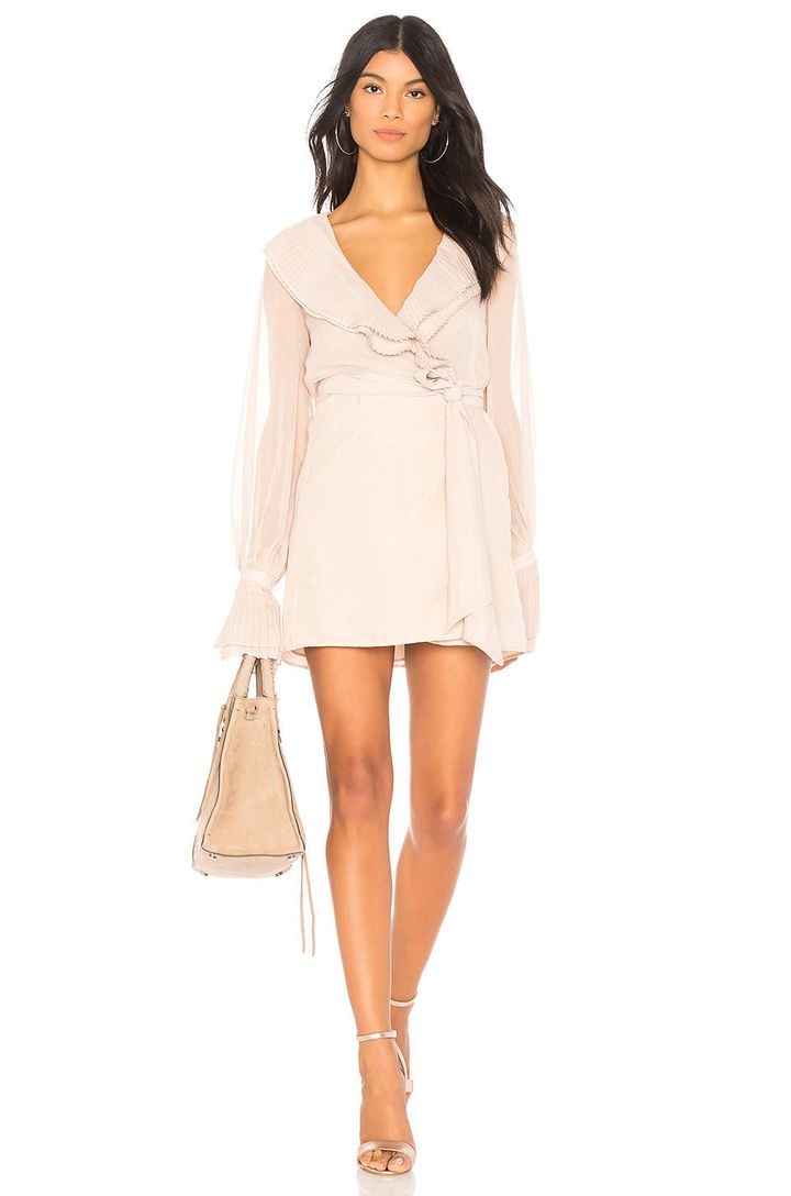 "<a href=""http://www.revolve.com/chrissy-teigen-x-revolve-sands-dress/dp/CTEI-WD4/?d=Womens&page=1&lc=12&itrownum="