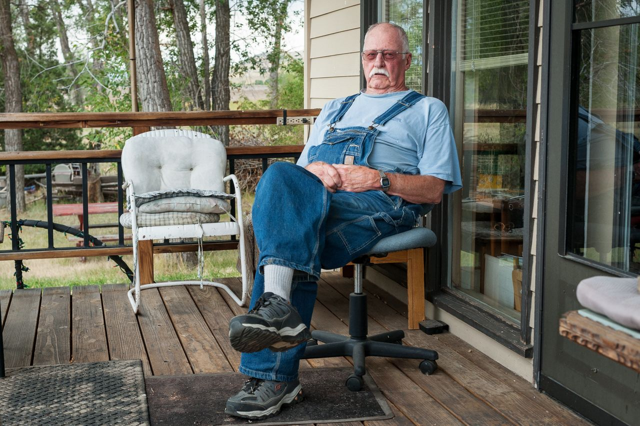 Bill Phillips, 77, on his front porch along the Yellowstone River east of Livingston. Phillips was a machinist for the railroad.