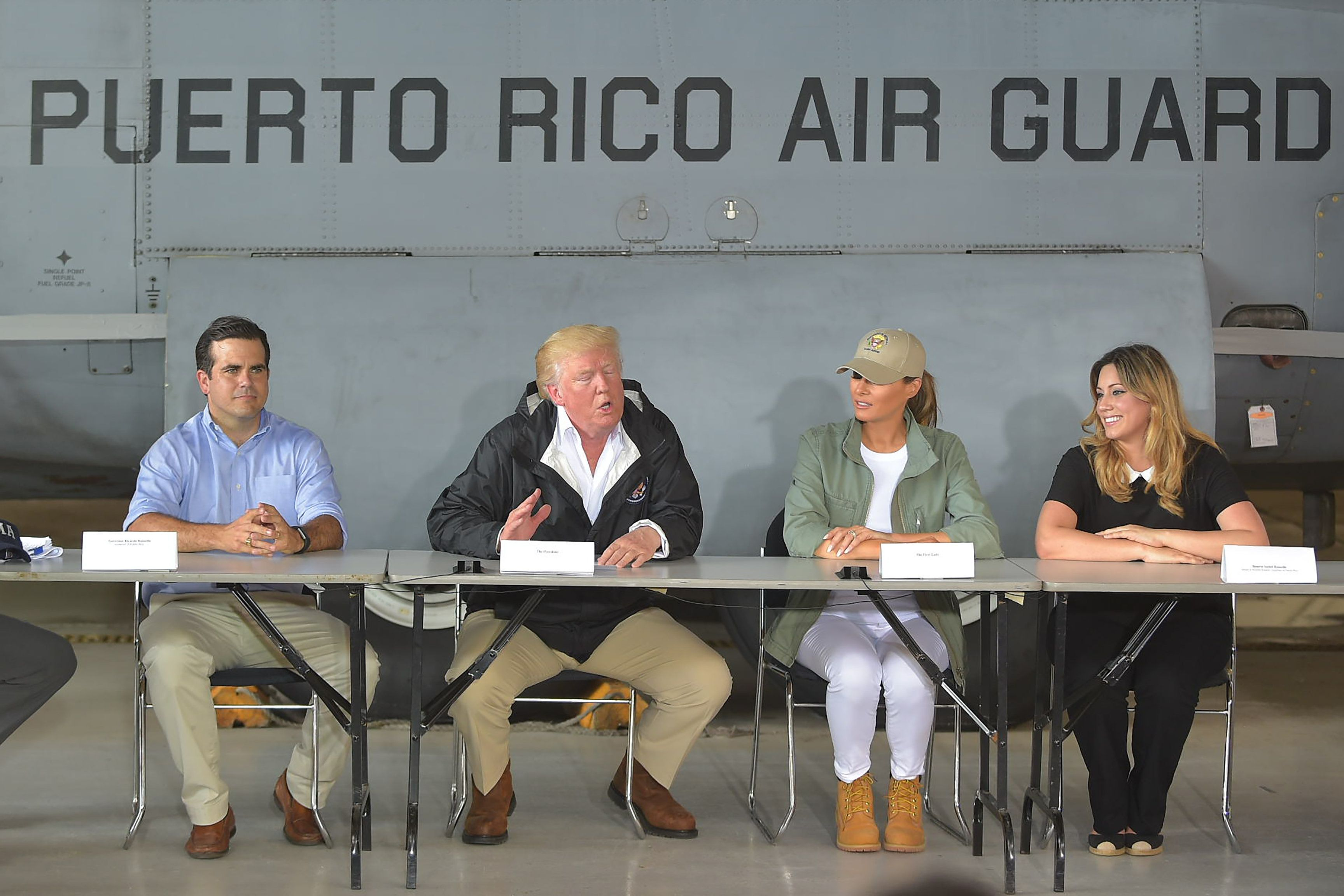 President Donald Trump, first lady Melania Trump and Puerto Rico Gov. Ricardo Rossello at a press briefing in Puerto Ric