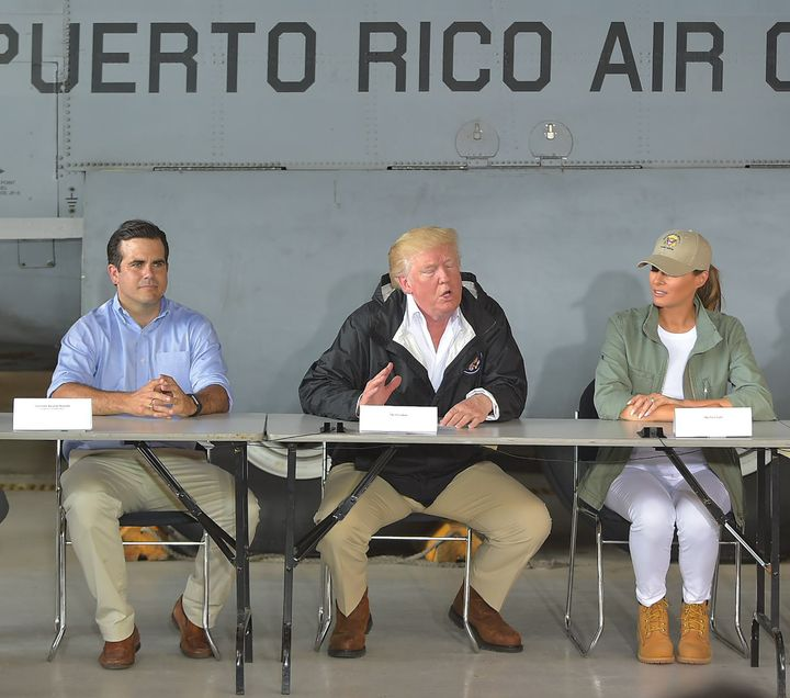 President Donald Trump, first lady Melania Trump and Puerto Rico Gov. Ricardo Rosselloat a press briefing in Puerto Ric