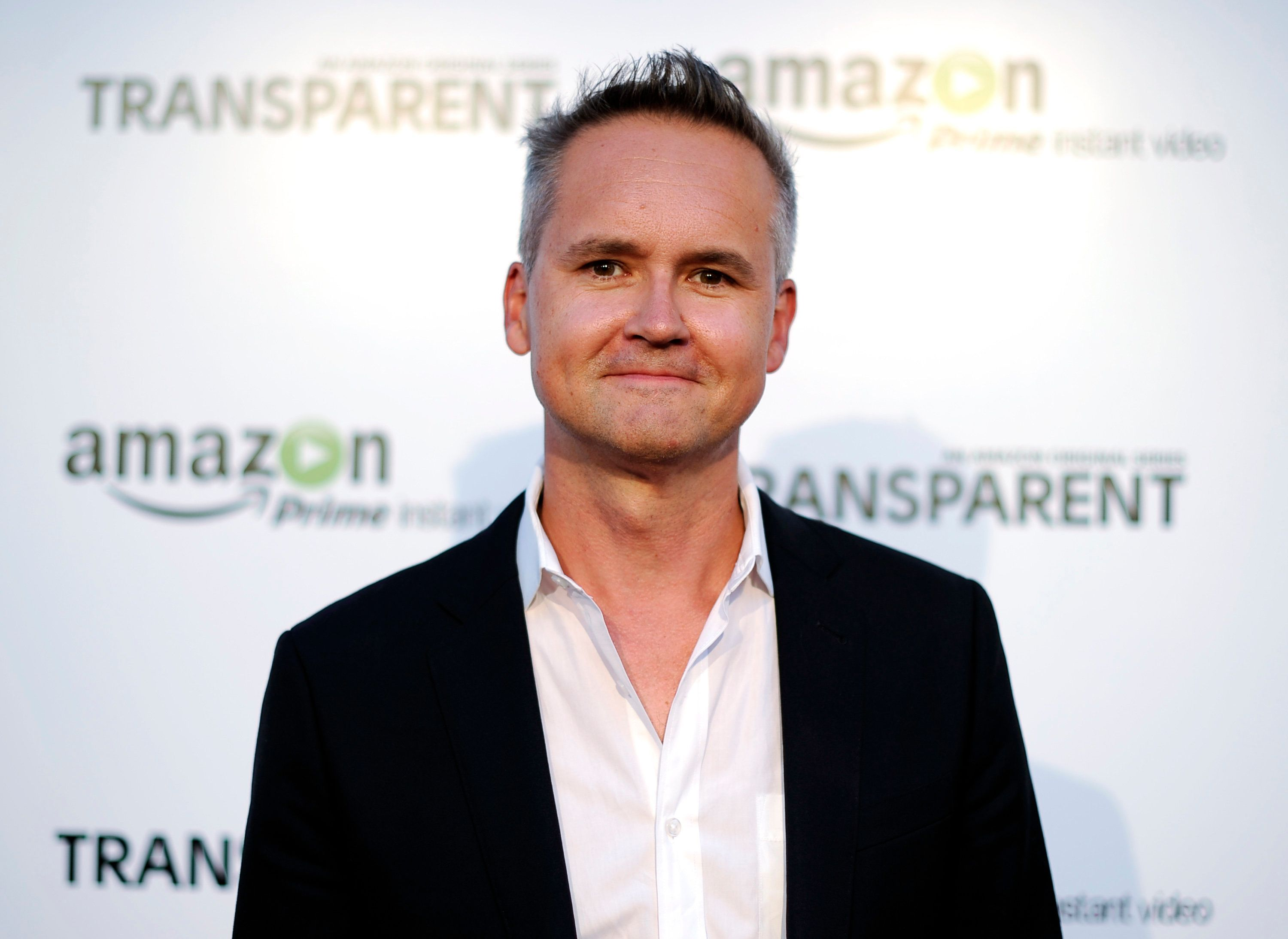 """Roy Price, Director of Amazon Studios, poses during Amazon's premiere screening of the TV series """"Transparent"""" at the Ace Hotel in downtown Los Angeles, California, September 15, 2014. REUTERS/Kevork Djansezian  (UNITED STATES - Tags: ENTERTAINMENT)"""