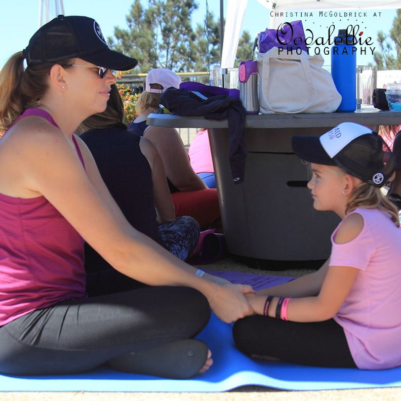 Sara and her daughter, Hannah, have a sweet moment while participating in the Listen & Share exercise.