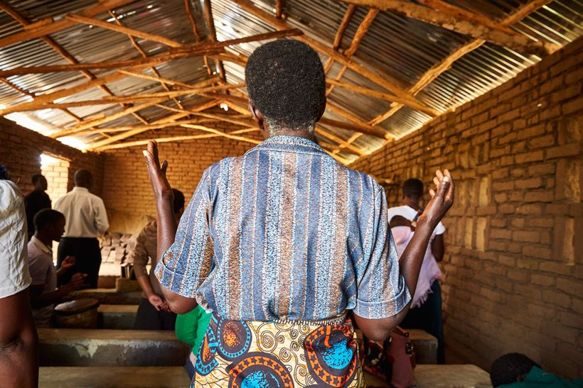 A woman prays during a Sunday morning service at Well of Life Church, Luchenza, southern Malawi.