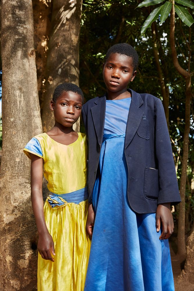 Two young churchgoers pose outside Well of Life Church after a Sunday morning service, Luchenza, southern Malawi, 2017.