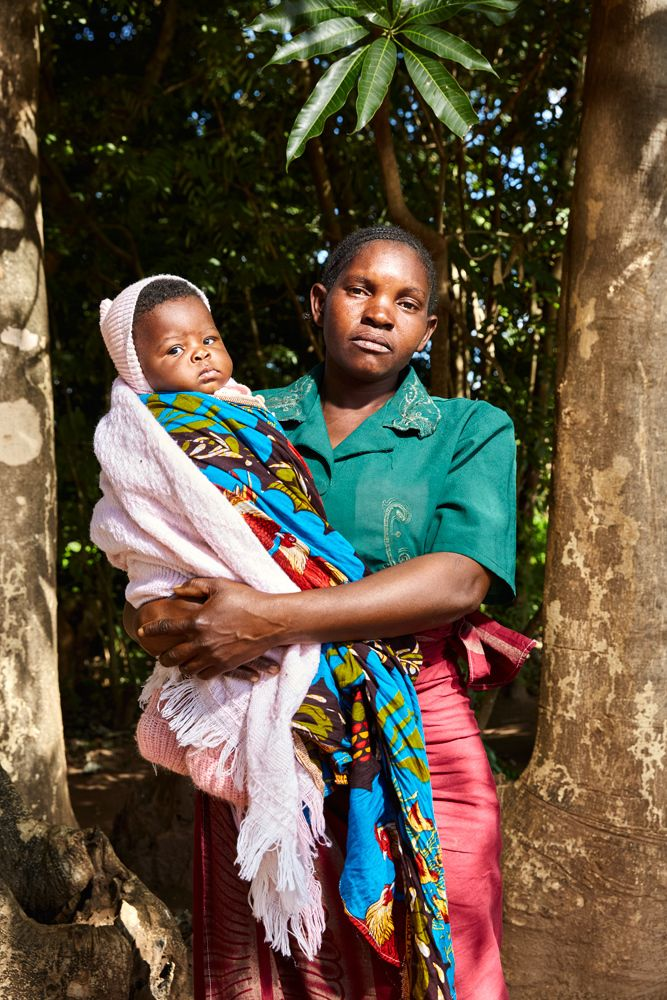 Mother and child pose outside Well of Life Church, Luchenza, southern Malawi, 2017. The little girl was just welcomed as the