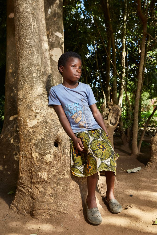 A young churchgoer poses outside Well of Life Church after a Sunday morning service, Luchenza, southern Malawi, 2017.
