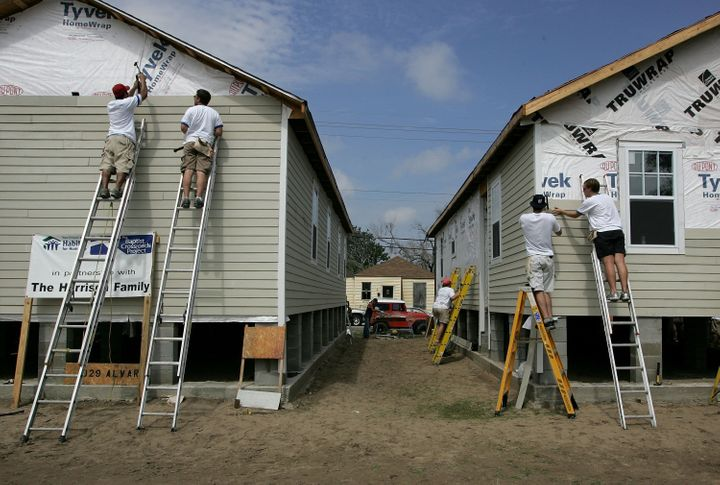 Volunteer construction workers with Habitat for Humanity build new homes August 23, 2006 in Upper Ninth Ward of New Orleans,