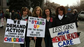 Jane Dougherty with two of her daughters and her sister Sue Connors at a gun violence prevention rally at the Colorado Capital January 2013