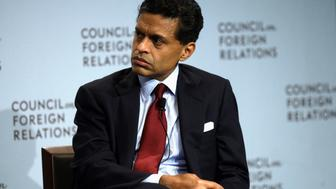 Journalist Fareed Zakaria listens as Prime Minister of Malaysia Najib Razak speaks at the Council of Foreign Relations during the United Nations General Assembly in New York September 26, 2013. REUTERS/Joshua Lott (UNITED STATES - Tags: POLITICS MEDIA)