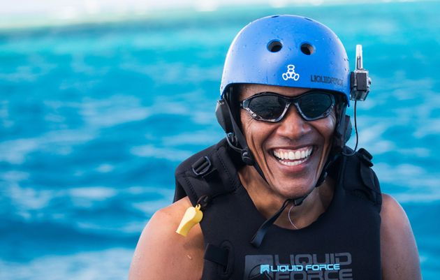 Obama takes a break from learning to kitesurf at Richard Branson's Necker Island retreat on February 1, 2017 in the British Virgin Islands.