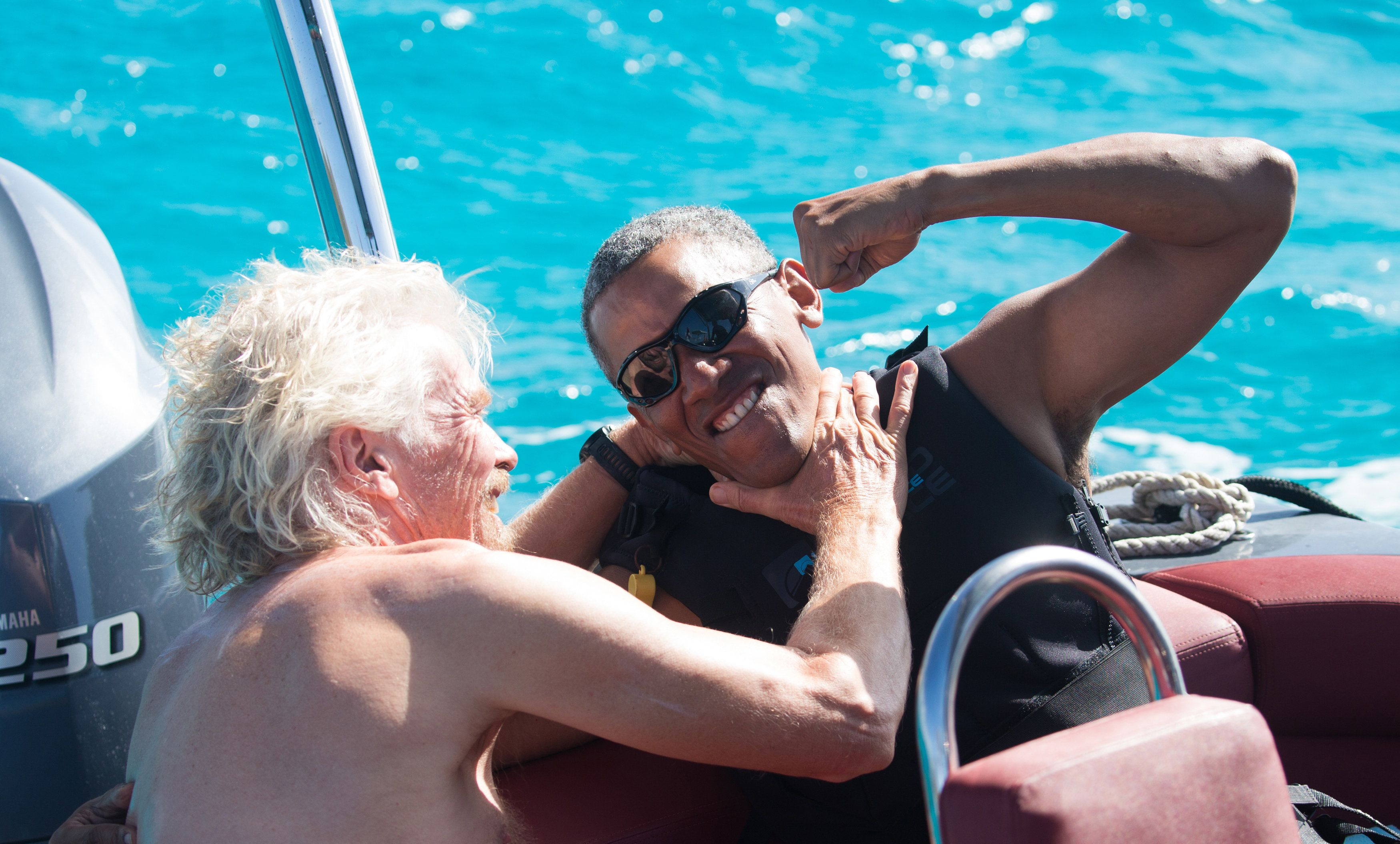THIS IMAGE IS BINNED  Former U.S. President Barack Obama and British businessman Richard Branson sit on a boat during Obama's holiday on Branson's Moskito island, in the British Virgin Islands, in a picture handed out by Virgin on February 7, 2017. Jack Brockway/Virgin Handout via REUTERS FOR EDITORIAL USE ONLY