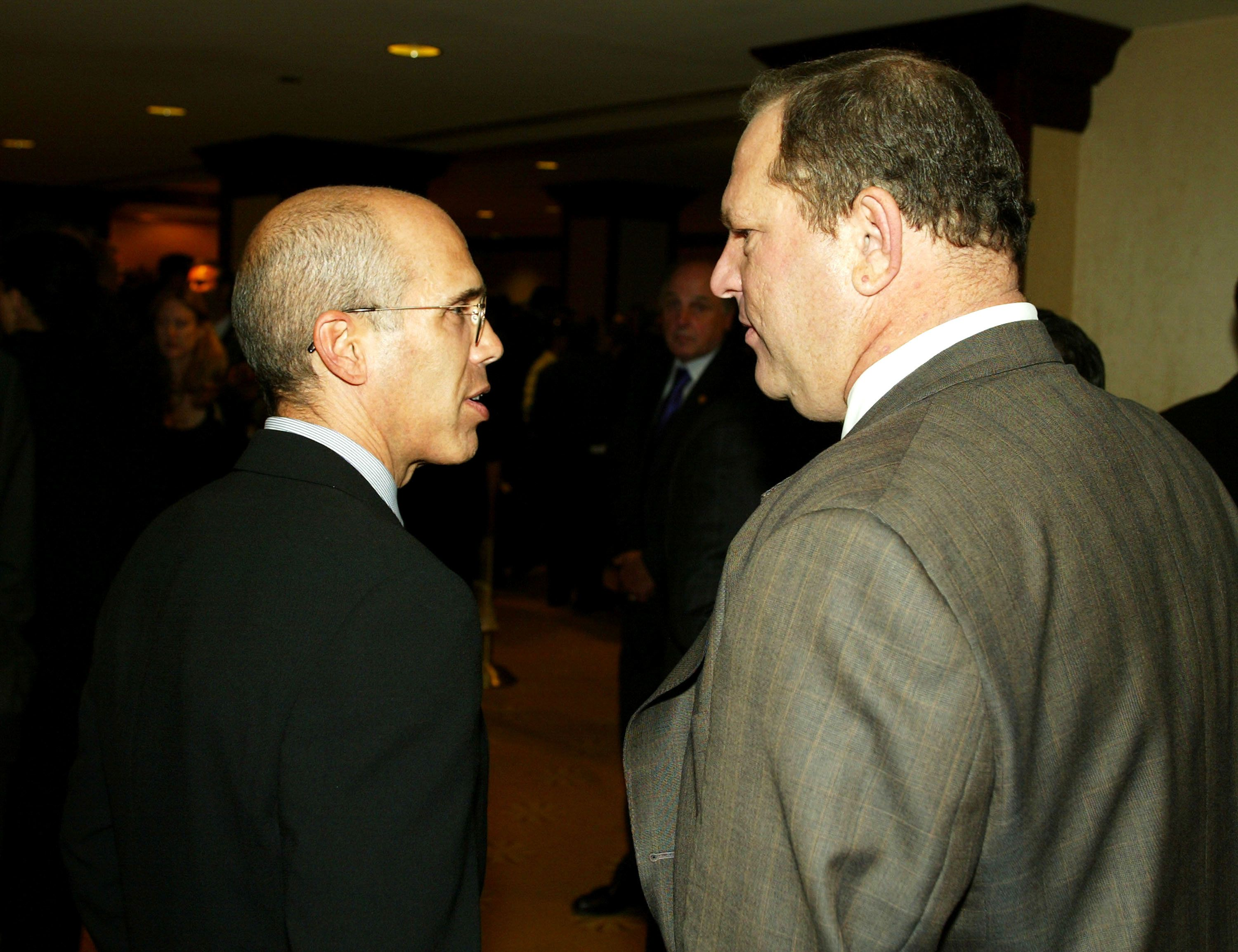 LOS ANGELES - SEPTEMBER 25:  Producers Jeffrey Katzenberg and Harvey Weinstein talk at the 29th Annual Dinner of Champions benefiting The National Multiple Sclerosis Society at the Century Plaza Hotel on September 25, 2003 in Los Angeles, California. (Photo by Kevin Winter/Getty Images)