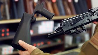 SALT LAKE CITY, UT - OCTOBER 5: A bump stock device (left), that fits on a semi-automatic rifle to increase the firing speed, making it similar to a fully automatic rifle, is shown next to a AK-47 semi-automatic rifle (right), at a gun store on October 5, 2017 in Salt Lake City, Utah. Congress is talking about banning this device after it was reported to of been used in the Las Vegas shootings on October 1, 2017.  (Photo by George Frey/Getty Images)