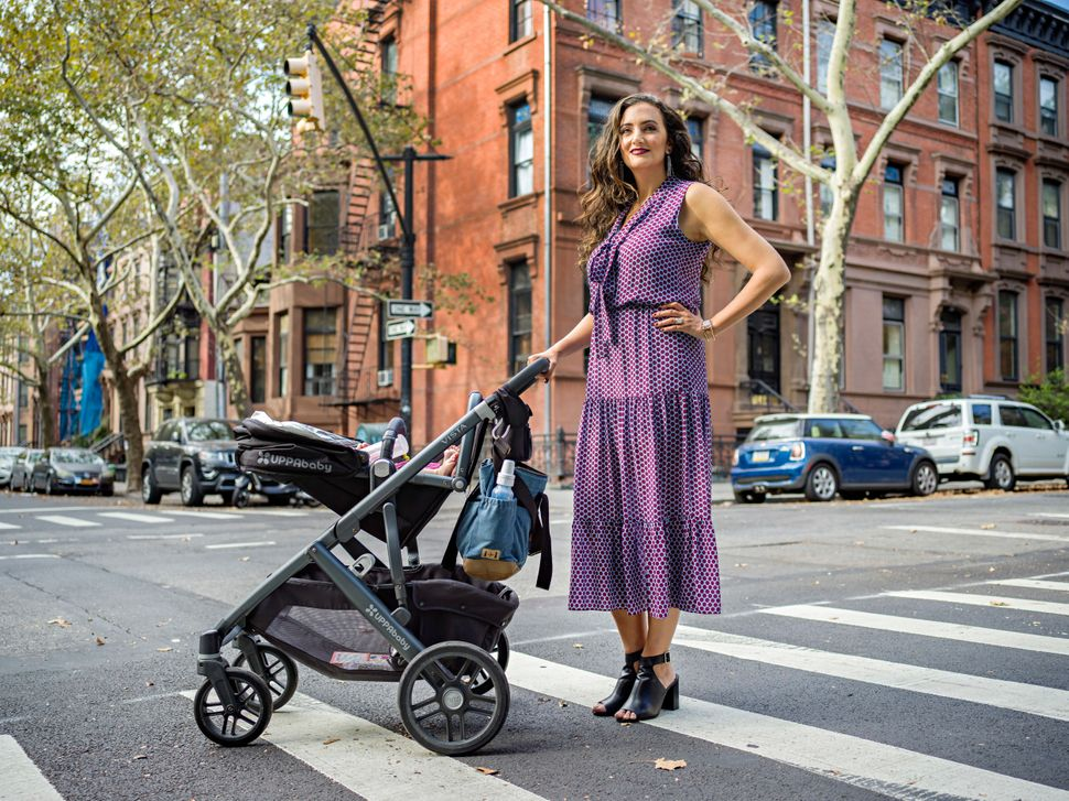 Rent the Runway co-founder Jennifer Hyman and her baby, Aurora, in Brooklyn, New York.
