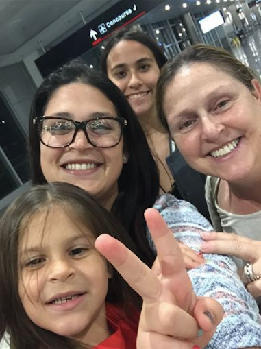 Deborah Drahus Capo (right) with (from bottom) her granddaughter, daughter and niece at the airport in San Juan, Puerto